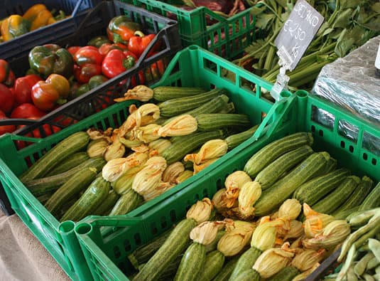 In season zucchini sold with their flowers, which can be stuffed with mozzarella and fried (a very popular snack in Rome)