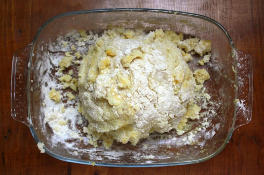 Mixing the ingredients together until the flour is moistened and the dough looks crumbly