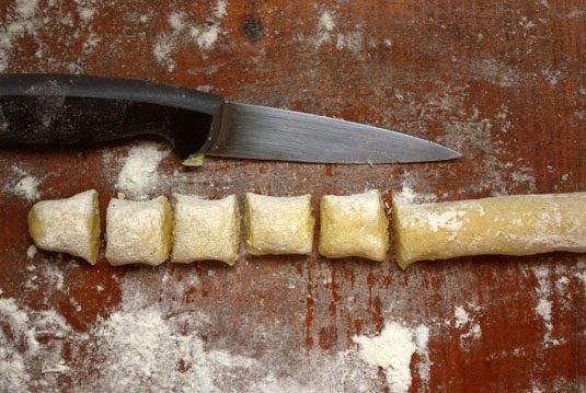 Gnocchi dough ropes, cut into squares.