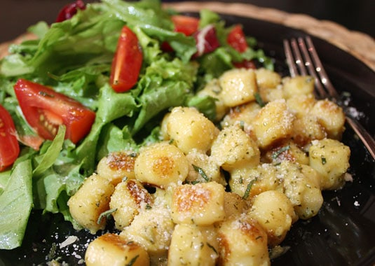 My gnocchi, as I served them in Rome: sauteed in butter and olive oil, with pesto, sprinkled with parmigiano-reggiano, accompanied by a fresh-from-the-market side salad.