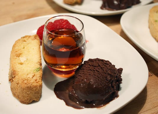 A sweet ending: White chocolate and pistachio biscotti, dark chocolate gelato and fresh raspberries with a glass of Vinsanto del Chianti Classico.