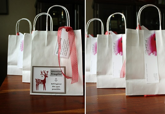 The bags, closed with a piece of ribbon, the address labels tied to it, and my business card stapled in the back.