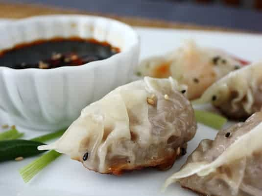 Beef dumpling wrapped with classic pleated crescent method.