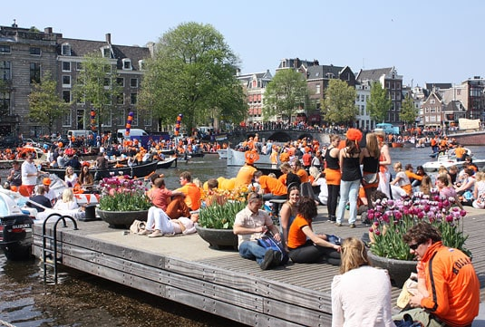 A colorful crowd on Queensday in Amsterdam
