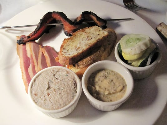 Appetizers from the Charcuterie menu at New Rivers Restaurant: Hickory smoked thick cut pork belly bacon, duck ham and fish rillettes, served with homemade breads, pickles and condiments.