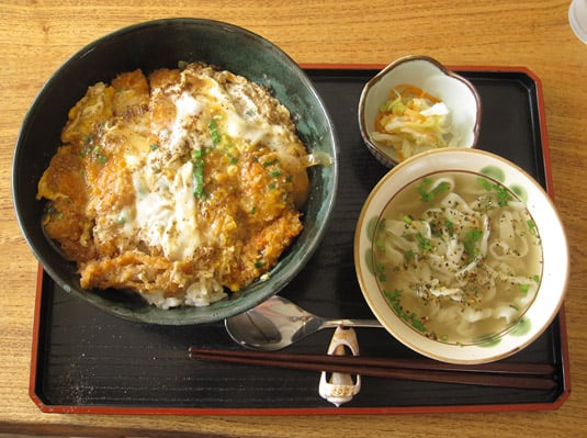 Katsudon: deep-fried pork cutlet topped with a raw egg, on rice.
