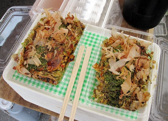 A take-out variety of okonomiyaki, at Kyoto's monthly Tenjin-san market.