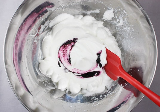 Adding food coloring to egg whites
