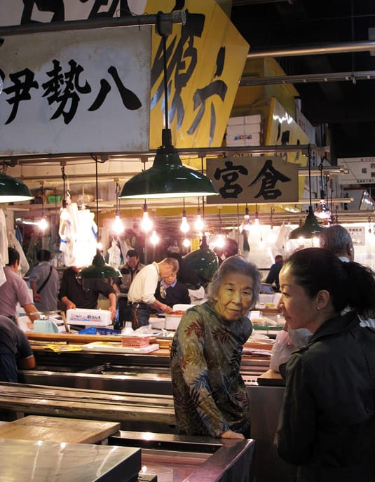 Our guide, Mika, on the right, with an old lady tending a booth at Tokyo's Tsukiji Fish Market.