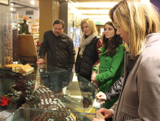 Our Foodie Tour group, listening and tasting delightful chocolates at Tony Caputo's, Salt Lake City.
