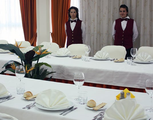 The banquet room at the Culinary Institute of Catania, with two students.