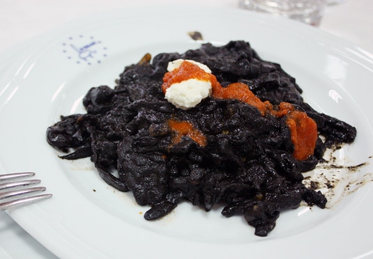 Hand-made cut tagliatelle with a squid ink sauce and ricotta
