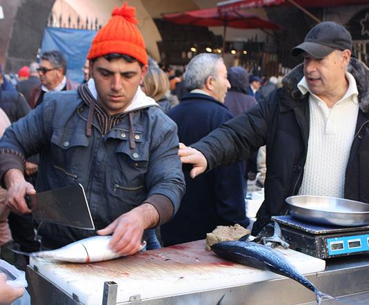 A worker at La Pescheria, fish market in Catania, Sicily