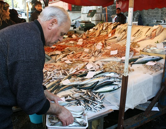 A worker at his stall at La Pescheria, fish market in Catania, Sicily