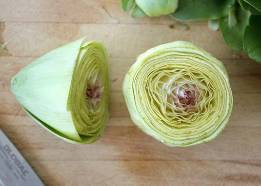 3. Cut the top of the artichoke off (about 2/3 from the top), exposing the center of the artichoke.