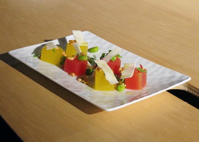 Chef Grégory Marchand's two melon salad with citrus oil, edamame peas, toasted pine nuts, chili, wild mint and ricotta salata, at the Omnivore Food Festival, Montreal / FoodNouveau.com