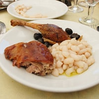 Roast Suckling Pig with Cannellini Beans, Amy's favorite dish in Val d'Orcia, Italy. / FoodNouveau.com