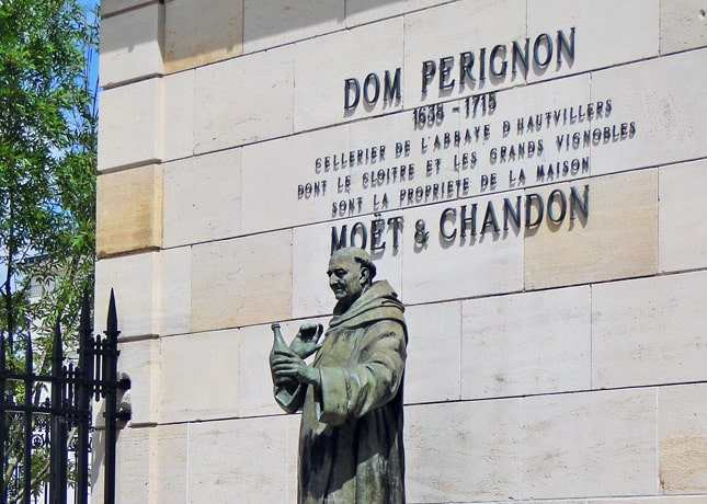 A statue of Dom Pérignon, the founder of the famous champagne house, in Épernay, France // Photo by fmpgoh, via Flickr Creative Commons // FoodNouveau.com