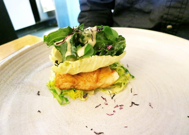 Seared turbot over sautéed cabbage, topped with a crispy cabbage leaf, chopped clams and oysters and a little green salad, Kadeau, Copenhagen // FoodNouveau.com