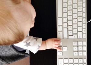 Baby J with hand on keyboard // FoodNouveau.com