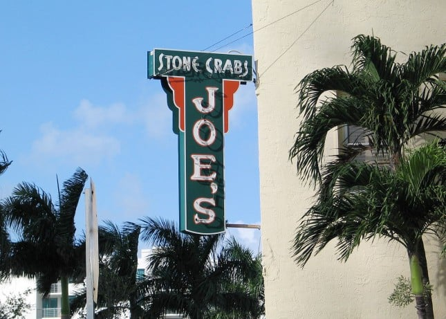 The neon sign of Joe's Stone Crabs in Miami Beach, Florida // FoodNouveau.com