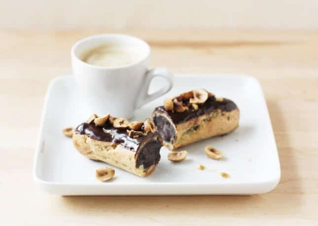 A chocolate éclair topped with toasted hazelnuts // FoodNouveau.com
