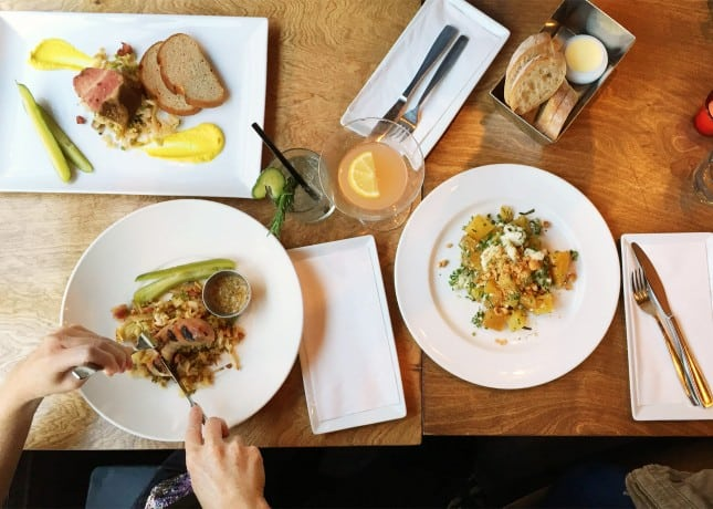 A food and cocktail spread at Le Cercle, named in the Best Bars and Best Brunches in Quebec City lists // FoodNouveau.com