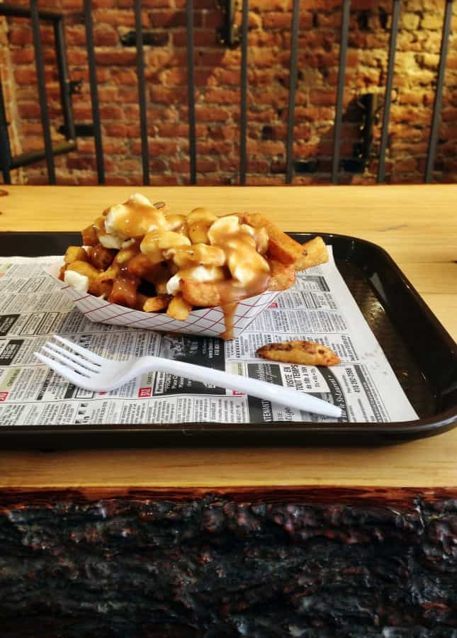 A delicious French fries, cheese, and gravy concoction at Snack Bar St-Jean, one of the Best Poutines in Quebec City // FoodNouveau.com