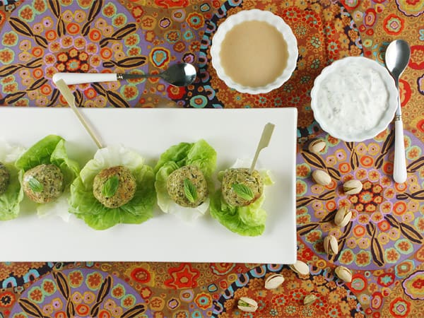 Baked Herb and Pistachio Falafel Bites with Mint Yogurt and Cashew Dressing // FoodNouveau.com