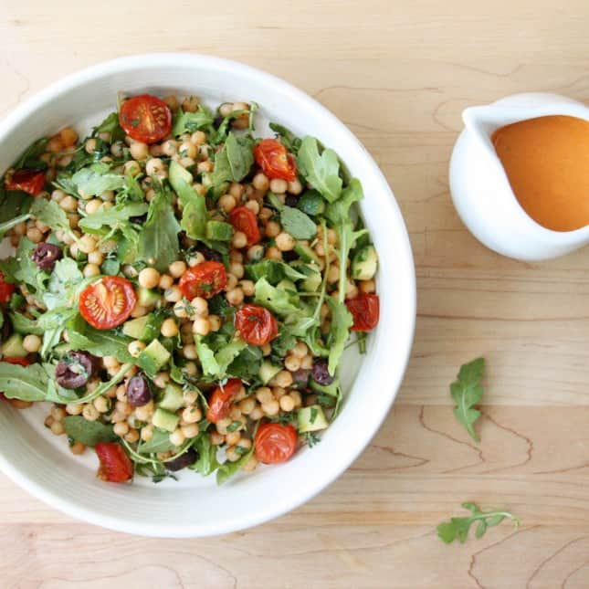 Black Olives and Arugula Israeli Couscous Salad with Roasted Cherry Tomato Vinaigrette // FoodNouveau.com