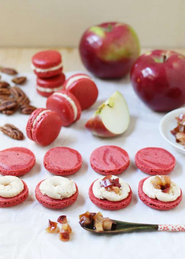 Never thought of macarons as comfort food? These Spiced Pecan Macarons with Caramelized Apple Buttercream will change your mind. They're like your favorite apple pie in a single bite! // FoodNouveau.com