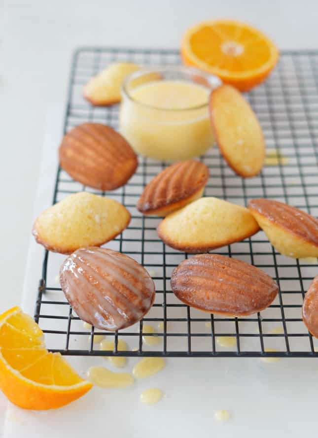 A simple orange glaze on classic madeleines // FoodNouveau.com