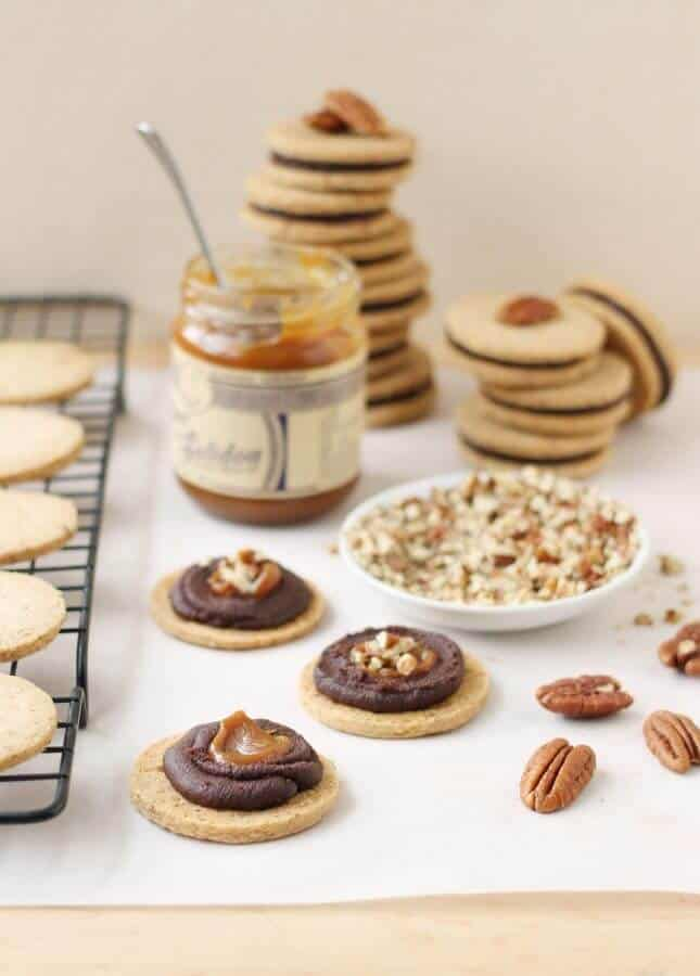 Pecan Shortbread Cookies with a Dark Chocolate Ganache and Caramel Filling // FoodNouveau.com