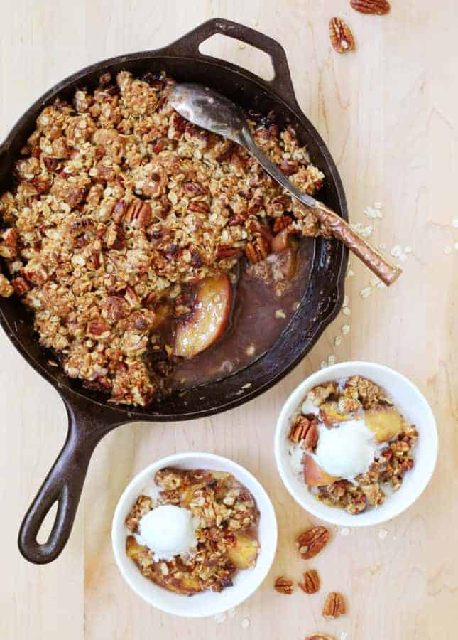This aromatic Bourbon Peach Crisp combines classic southern ingredients to produce a dessert that marries jammy fruits and a crunchy topping. // Bourbon Peach Crisp // FoodNouveau.com