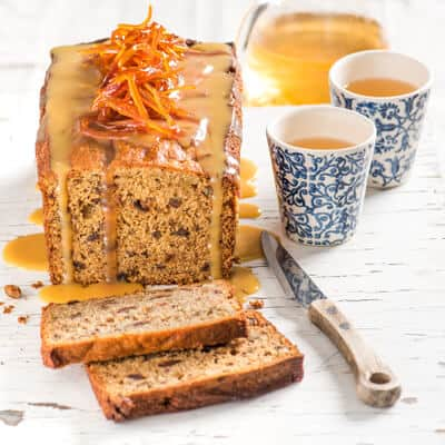 Orange, Date, and Walnut Cake with Orange Butterscotch Sauce, a recipe from the cookbook Simply Citrus by Marie Asselin