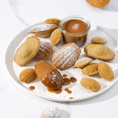Spiced Madeleines with Salted Caramel Sauce, a recipe from the cookbook French Appetizers, by Marie Asselin