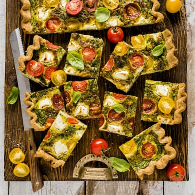 Cherry Tomato, Spinach, and Goat Cheese Sheet Pan Quiche, a recipe from the cookbook French Appetizers, by Marie Asselin
